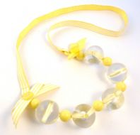 Quirky Yellow Ribbon, Bow And Clear Bead Necklace.